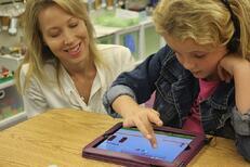 Teacher helpign student with ST Math