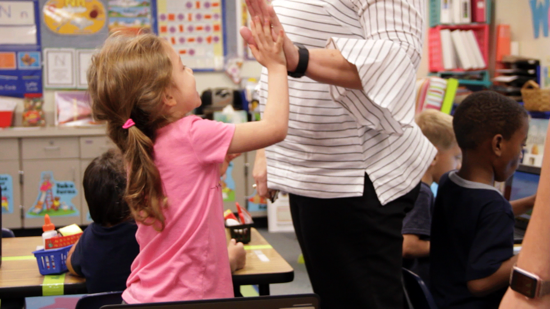 student-girl-teacher-high-five