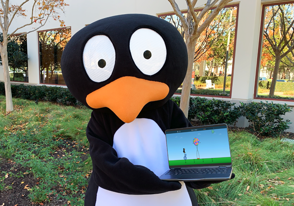 JiJi in mascot costume holds a Chromebook with new ST Math