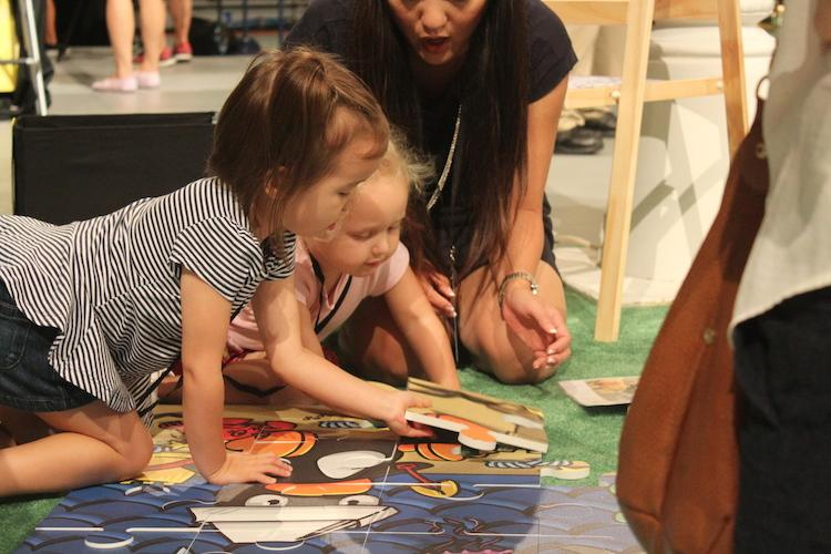 early learners solve puzzles at the math fair