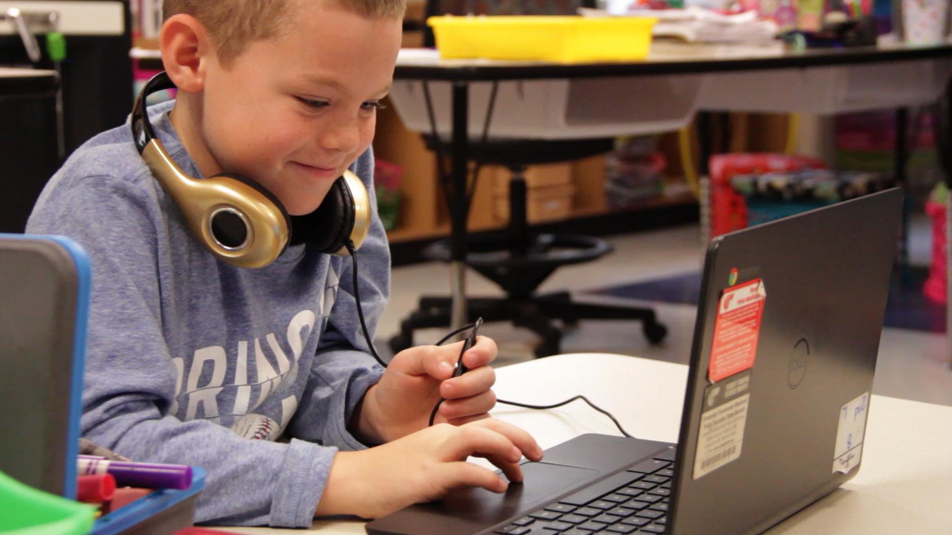 boy-smiling-laptop-brazosport-st-math