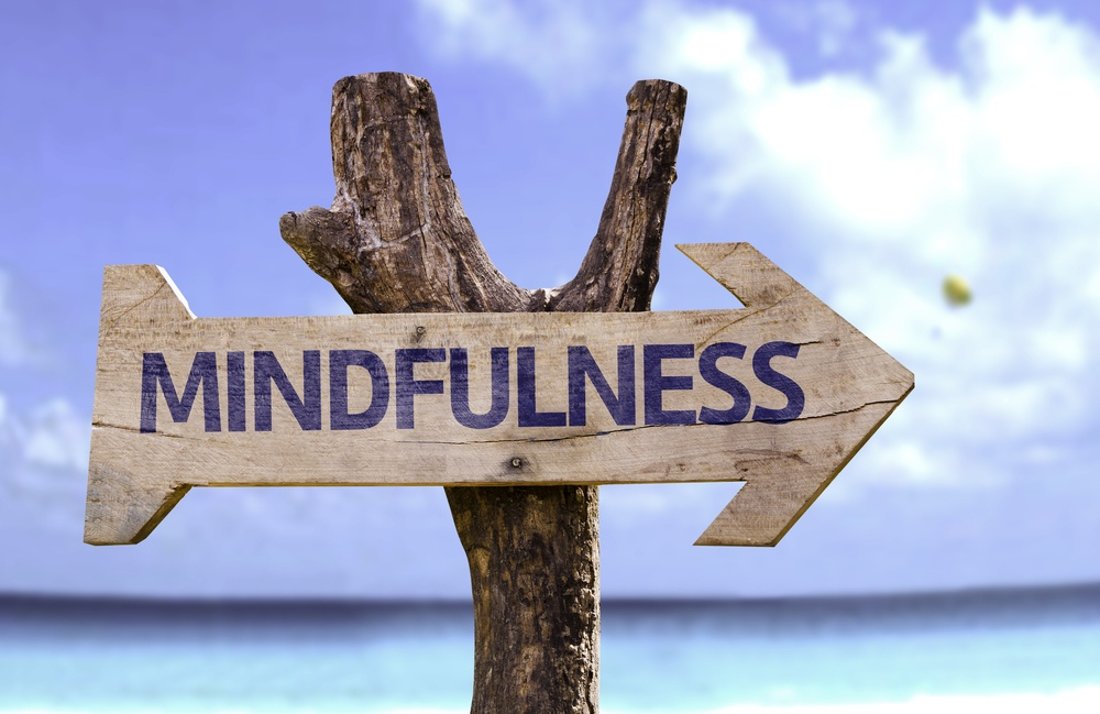 Mindfulness wooden sign with a beach on background.jpeg