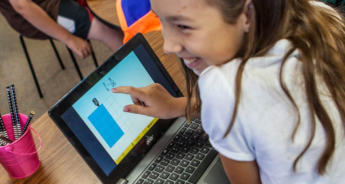 mathematical-discourse-st-math-fraction-girl-smiling-laptop